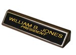 "28BW - 2"" x 8"" Black Brass Nameplate on Wood"